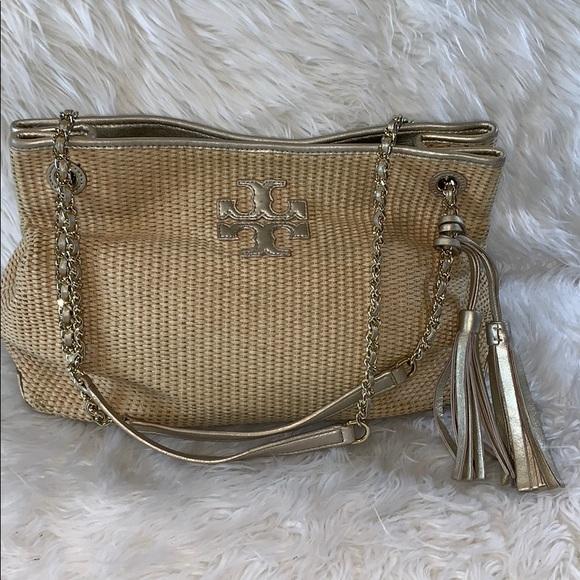 d52f6496b481 Tory Burch straw bag with gold leather trim. M 5bab93d89539f7c14c4103d9